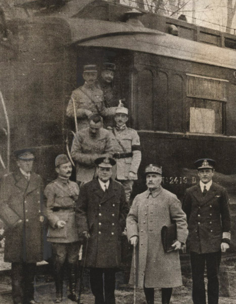 Photograph taken after reaching agreement for the armistice that ended World War I. This is Ferdinand Foch's own railway carriage and the location is the Forest of Compiègne. Foch is second from the right. Left of Foch in the photo (on Foch's own right) is the senior British representative, Sir Rosslyn Wemyss. On the right is Admiral George Hope. (public domain; photographer unknown, via The National World War I Museum and Memorial)