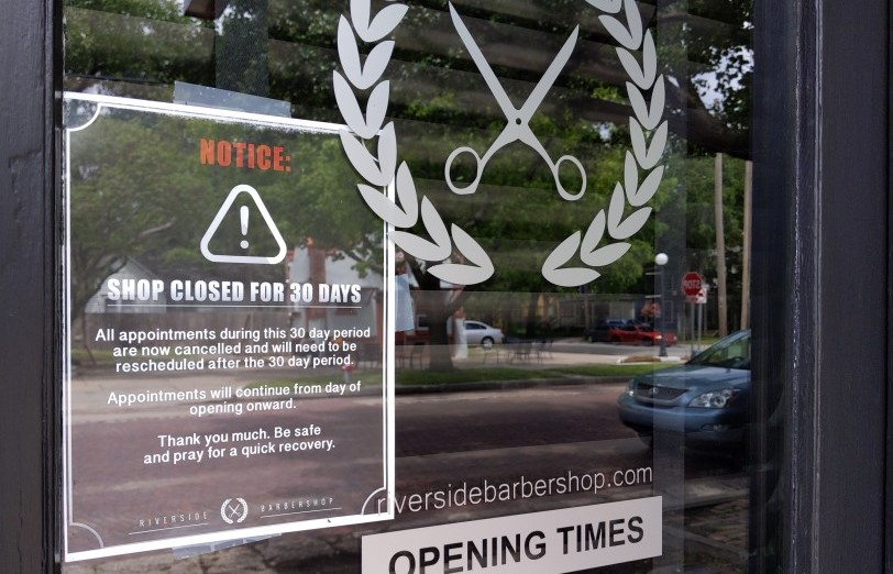 (A barber shop in downtown Wichita was closed May 14, as it was not part of Governor Laura Kelly's first wave of businesses that could reopen. It'll be allowed to resume haircuts on Monday, May 18. (Photo by Stephan Bisaha, KMUW)