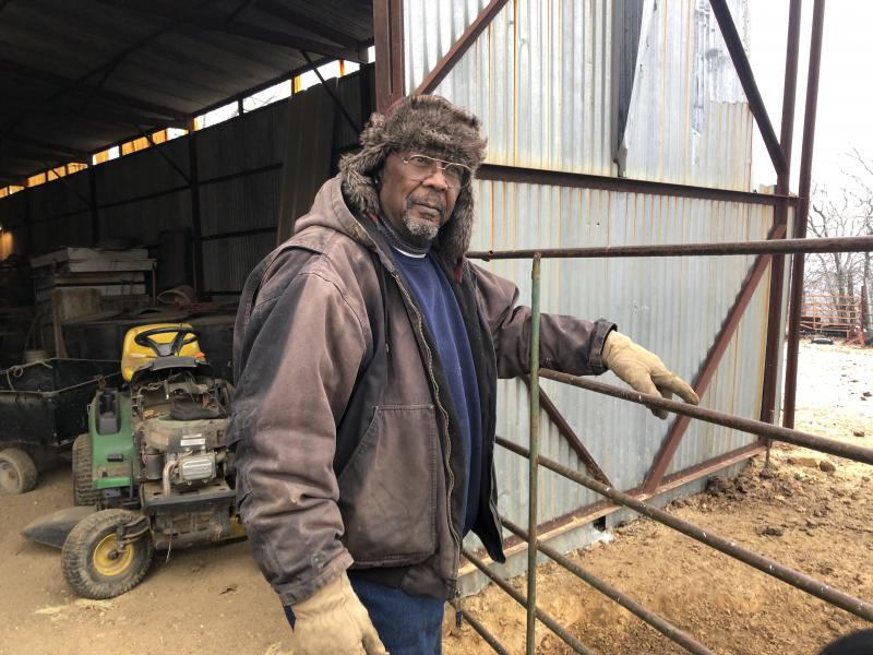 Alvin Lee stands beside his barn on his 160-acre farm near Wewoka, Oklahoma. (Photo by Seth Bodine / Harvest Public Media)