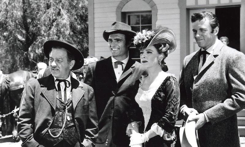 "In this still shot from TV's ""Gunsmoke"" series, Burrton, Kansas native Milburn Stone (L) played Doc, Dennis Weaver played Chester, Amanda Blake played Miss Kitty and James Arness (R) portrayed Matt Dillon.  (Photo Courtesy of Boot Hill Museum, Dodge City, Kan.)"