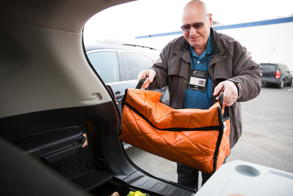 A Meals on Wheels volunteer places meals into his car to deliver to senior citizens and homebound members in the community. (Photo provided by Meals on Wheels)
