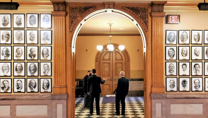 Legislators outside the door to the Kansas House. (Photo: Stephen Koranda, Kansas News Service)