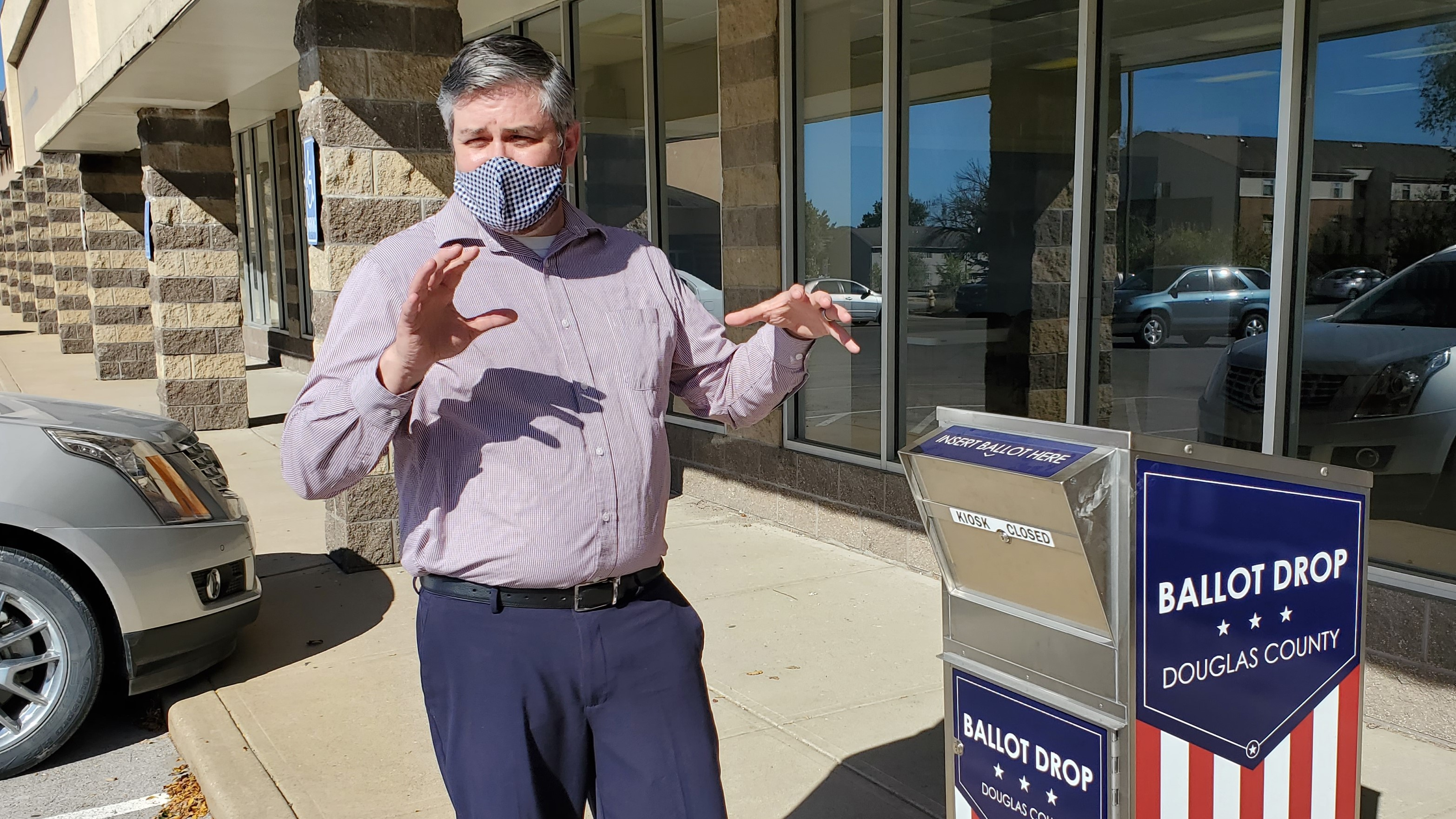 Douglas County Clerk Jamie Shew with one of the county's ballot drop boxes. (Photo by Stephen Koranda)