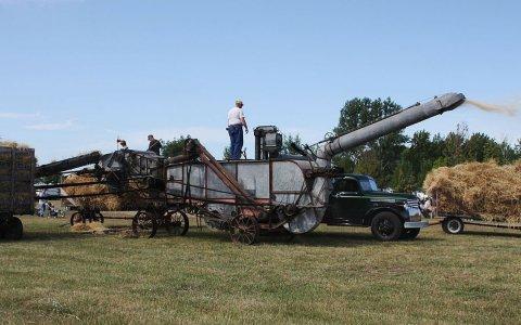 A threshing machine in operation. (Photo from Wikipedia)