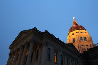 Twilight accentuates the new copper dome on the Kansas Statehouse, part of a nearly complete $332 million renovation and the first new copper covering since the roof was constructed in 1903. (Flickr Photo by Phil Cauthon / KHI)