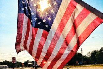 An American flag hangs in downtown Arlington, Kansas. (Photo by J. Schafer)