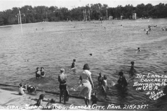 """View of """"The Big Dipper"""" located in Garden City, Kansas. At the time, the pool was 218 ft. x 337 ft., and located in Finnup Park. Date: Between 1920 and 1939 (Photo Courtesy of Kansas Historical Society/kansasmemory.org)"""