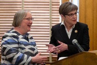 Gov. Laura Kelly (left) is proposing the creation of a new state agency that would incorporate several welfare programs, including the entire Department for Children and Families. Laura Howard (left) would oversee the new agency. (Photo by Evert Nelson, The Topeka Capital-Journal)