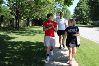Sara Hart Weir (right) walked in an Olathe subdivision during a July 11 canvassing event. (Photo by Aviva Okeson-Haberman, Kansas News Service)
