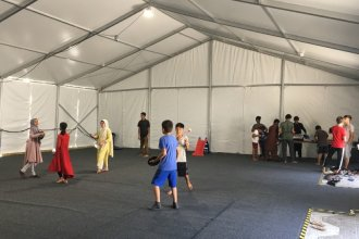 The scene at Fort Pickett in Virginia, where families evacuated from Afghanistan are being processed before heading to their new homes. (Photo from Hillary Snyder, Catholic Charities of Southwest Kansas)