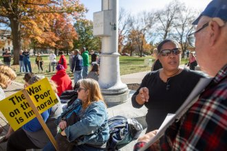 Shelley Owens of Topeka, right, attended a protest of the Kansas foster care system Saturday, saying her three grandchildren were arbitrarily taken from her. She said the agency has traumatized the children and her family. (photo credit: Evert Nelson / Topeka Capital-Journal via Kansas News Service)