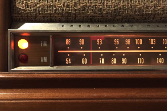 AM/FM dial on a vintage Sears Silvertone radio (Photo by J. Schafer)