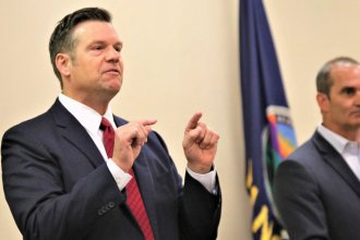 Republican candidate for U.S. Senate, Kris Kobach, speaking at a debate earlier this year with rival Bob Hamilton looking on. (Photo by Jim McLean, Kansas News Service)