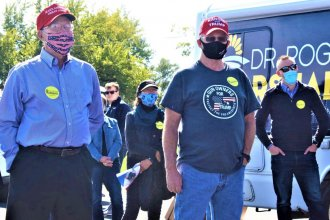 El Dorado resident Hal Neukirch (right) attends an Oct. 3 rally for U.S. Senate candidate Roger Marshall and other Republican candidates. (Photo by Jim McLean, Kansas News Service)