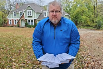 Doug Reed at the home where the letters from KDOL arrived. (Photo by Stephen Koranda)