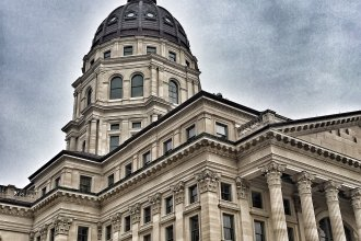 Dark clouds gather over the Kansas Statehouse (File photo by J. Schafer)