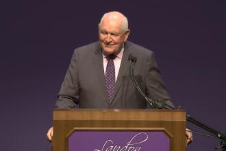 Sonny Perdue at KSU podium