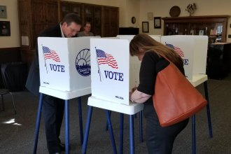 Voters fill out ballots Tuesday at a polling place in Topeka. (Photo by Stephen Koranda)