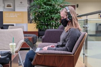 A Wichita State University student sits in the school's student center. (Photo by Stephan Bisaha, Kansas News Service)