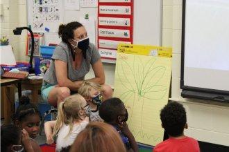 Kim Welch, a Wichita preschool teacher, leads a class during a half-day summer program at Cessna Elementary School. (Photo by Suzanne Perez, KMUW)