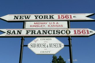 "The town of Kinsley, in Edwards County, is often referred to as ""Midway USA"" because it is supposedly the halfway or midway point between New York City and San Francisco. The city of Kinsley even erected a sign reflecting this factoid. (Flickr Photo by Franklin B. Thompson)"