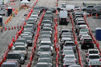 Lines and lines of cars are seen as drivers wait on Monday to be tested for COVID-19 at a coronavirus testing site in Miami Gardens, Fla.