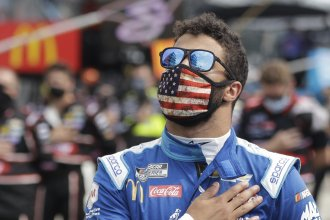 NASCAR Cup Series driver Bubba Wallace stands during the national anthem before a NASCAR auto race Sunday at the Indianapolis Motor Speedway in Indianapolis.