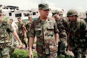 Gen. Colin Powell, head of the Joint Chiefs of Staff, tours the bombed courtyard of the Panamanian Defense Force Comandancia in Panama City during the U.S. invasion of Panama on Jan. 5, 1990.