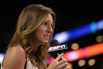 ESPN reporter Allison Williams reports from a college basketball tournament at Barclays Center in Brooklyn, N.Y., on March 8, 2017. Williams said in a recent Instagram video that she is leaving ESPN due to the company's vaccine mandate.