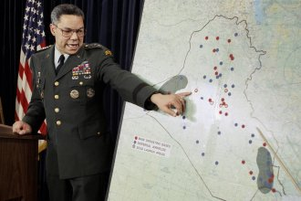 Chairman of the Joint Chiefs of Staff Colin Powell points to Iraqi airbases at a Pentagon briefing on Jan. 23, 1991. Powell became a household name during the first Gulf War.