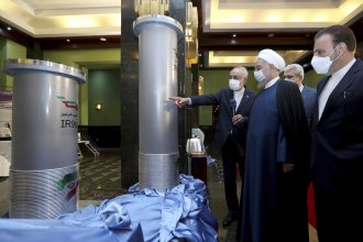 Iranian President Hassan Rouhani (second right) listens to head of the Atomic Energy Organization of Iran Ali Akbar Salehi while visiting an exhibition of Iran's new nuclear achievements in Tehran on Saturday.
