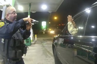 Officer Joe Guttierez aims his weapon at Lt. Caron Navario during a traffic stop. Navario is suing Guttierez and the other officer, Daniel Crocker, for violation of his constitutional rights.