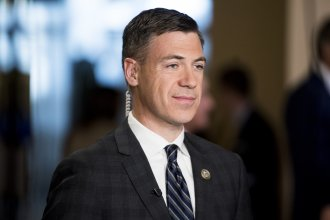 Rep. Jim Banks, R-Ind., seen before a television interview, is pushing his party to focus on working class voters as a way to win back the House of Representatives in the 2022 midterms and the White House in 2024.