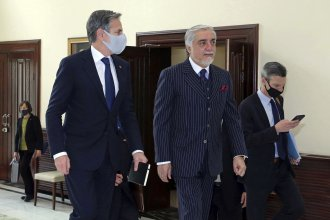 Abdullah Abdullah, chairman of the High Council for National Reconciliation (center), walks with Secretary of State Antony Blinken at the Sapidar Palace in Kabul on Thursday.