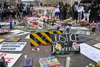 Protesters gathered at a memorial a Louisville, Ky. park on March 13, 2021, the anniversary of Breonna Taylor's killing. Jonathan Mattingly, one of the officers involved in the fatal raid, is facing widespread criticism for planning to publish a book about it.