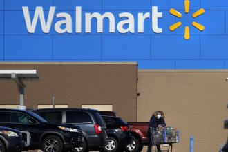 A Walmart store in Derry, N.H., seen in November 2020. The company says fully vaccinated customers need not wear masks, and vaccinated workers won't need to wear them starting Tuesday. The company won't require proof of status.