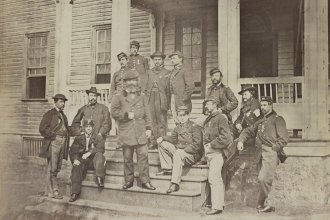 General John Sedgwick and his staff on the steps of the headquarters of the 6th Army Corps. [photographed between 1861 and 1864] (Photo via Library of Congress)