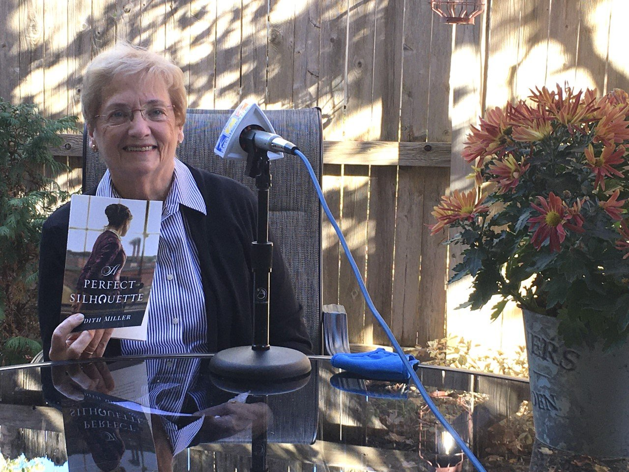 Photo of Judith McCoy Miller with book