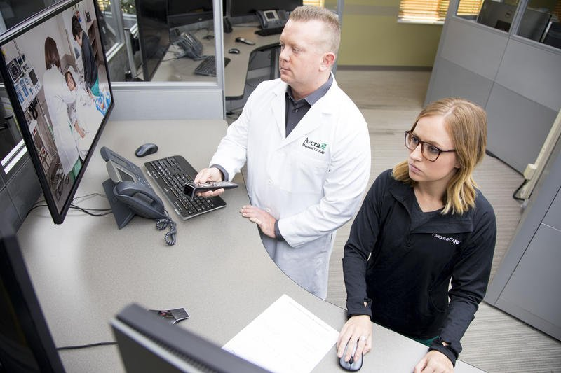 Brian Skow, an emergency room specialist, and nurse Amanda Sandager respond to a video call at Avera eCARE telemedicine center in Sioux Falls, South Dakota. (Photo Courtesy of Avera Care.)